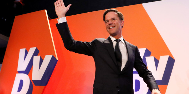 Dutch Prime Minister Mark Rutte of the VVD Liberal party appears before his supporters in The Hague, Netherlands, March 15, 2017.  REUTERS/Yves Herman      TPX IMAGES OF THE DAY