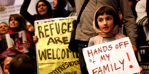 Rosalie Gurna, 9, holds a sign in support of Muslim family members as people protest against U.S. President Donald Trump's travel ban on Muslim majority countries, at the International terminal at Los Angeles International Airport (LAX) in Los Angeles, California, U.S., January 28, 2017.  REUTERS/Patrick T. Fallon TPX IMAGES OF THE DAY