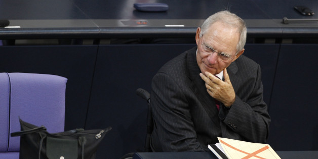 German Finance Minister Wolfgang Schaeuble attends a session of the Bundestag, the lower house of parliament, before a vote on a Spanish bank aid package in Berlin, July 19, 2012. Chancellor Angela Merkel's authority within her centre-right coalition was at stake on Thursday when uneasy German lawmakers vote on Berlin's contribution to a euro zone aid package for Spain's ailing banks. REUTERS/Thomas Peter (GERMANY - Tags: POLITICS BUSINESS)