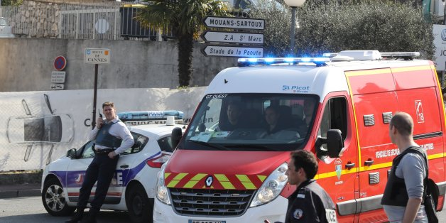 Policemen stand near a police and a firefighter vehicle in the southern French town of Grasse, on March 16, 2017 following a shooting in the Tocqueville high school that left two people injured. At least two people were injured in a shooting at a high school in the southern French town of Grasse on March 16, 2017 which saw the head teacher targeted, police and local authorities said. One 17-year-old pupil armed with a rifle, two handguns and two grenades was arrested after the shooting at the Tocqueville high school, a police source told AFP, asking not to be named.  / AFP PHOTO / Valery HACHE        (Photo credit should read VALERY HACHE/AFP/Getty Images)
