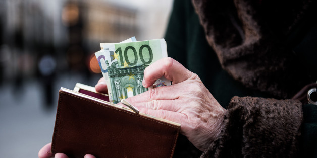 A customer places euro banknotes into a purse ahead of the 171st Organization of Petroleum Exporting Countries (OPEC) meeting in Vienna, Austria, on Tuesday, Nov. 29, 2016. An OPEC deal to curtail oil production appeared in jeopardy as Iran said it wont make cuts while Saudi Arabia insisted Tehran must be willing to play a meaningful role in any agreement. Photographer: Akos Stiller/Bloomberg via Getty Images