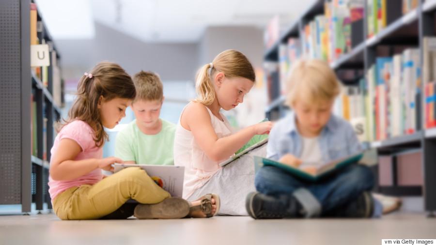 kid at library