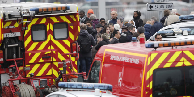 Repeating correcting date - Passengers wait amongst emergency vehicles at Orly airport southern terminal after a shooting incident near Paris, France March 18, 2017.  REUTERS/Benoit Tessier