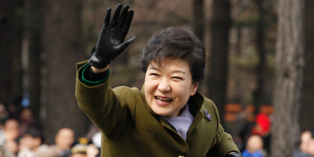 South Korea's new President Park Geun-Hye waves after her inauguration ceremony at parliament in Seoul on February 25, 2013. Park Geun-Hye became South Korea's first female president on February 25, vowing zero tolerance with North Korean provocation and demanding Pyongyang 'abandon its nuclear ambitions' immediately.   AFP PHOTO / POOL / Kim Hong-Ji        (Photo credit should read Kim Hong-Ji/AFP/Getty Images)