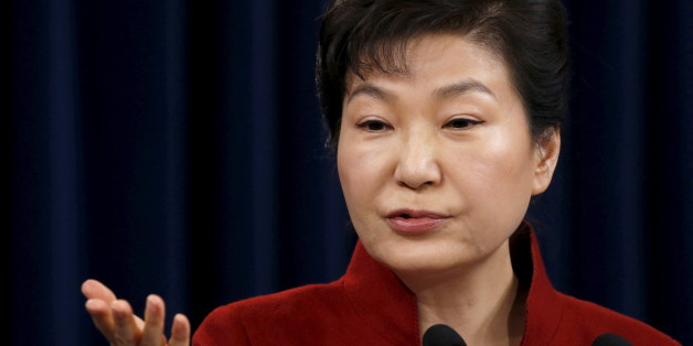 South Korean President Park Geun-hye answers questions from reporters during her New Year news conference at the Presidential Blue House in Seoul, South Korea, January 13, 2016.  REUTERS/Kim Hong-Ji