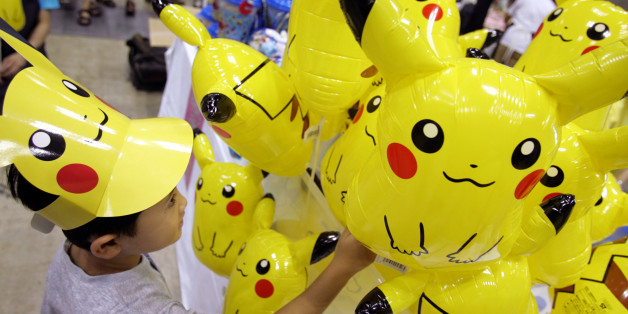 A Japanese boy chooses a Pokemon balloon during Pokemon Festa 2005 in Yokohama, south of Tokyo August 20, 2005. Over 900,000 people attended the largest Pokemon event in Japan in nine places during this summer. REUTERS/Toru Hanai  TH/KI
