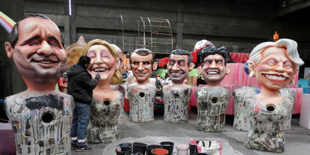 A worker puts the final touches to giant figures of French politicians (L-R) French President Francois Hollande, Marine Le Pen, Alain Juppe, Emmanuel Macron, Nicolas Sarkozy, Jean-Luc Melenchon and Michele Alliot-Marie during preparations for the carnival parade in Nice, France, January 26, 2017.     REUTERS/Eric Gaillard