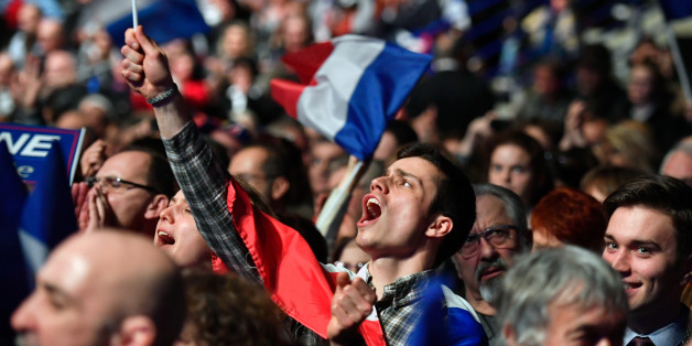NANTES, FRANCE - FEBRUARY 26:  Far right supporters attend a presidential campaign rally by National Front Leader Marine Le Pen at the Zenith Metropole on February 26 2017 in Lyon, France. One of the most unpredictable French elections is being closely fought, with National Front leader promising to protect the electorate from globalization. The 48 year old daughter of the party founder Jean Marie Le Pen has manifesto pledges such as taxing job contracts for non-nationals and proposing to leave