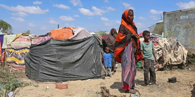 MOGADISHU, SOMALIA - MARCH 8: Somalian people try to continue their lives in tents without water and electricity as they fight against hunger and lack of water due to drought in Kaxda district of Moghadishu, Somalia on March 8, 2017.  (Photo by Sadak Mohamed/Anadolu Agency/Getty Images)
