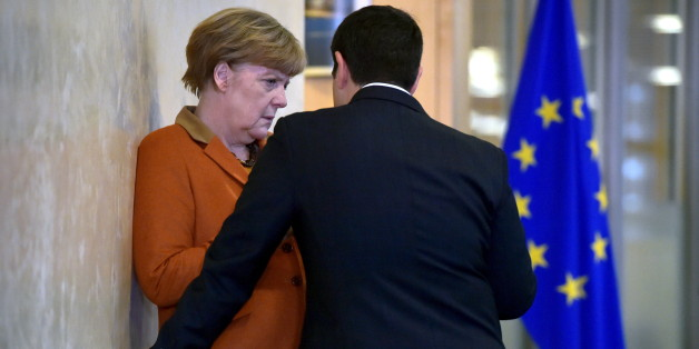 Greece's Prime Minister Alexis Tsipras (R) chats with Germany's Chancellor Angela Merkel prior to a meeting over the Balkan refugee crisis with leaders from central and eastern Europe at the EU Commission headquarters in Brussels, Belgium, October 25, 2015. REUTERS/Eric Vidal      TPX IMAGES OF THE DAY