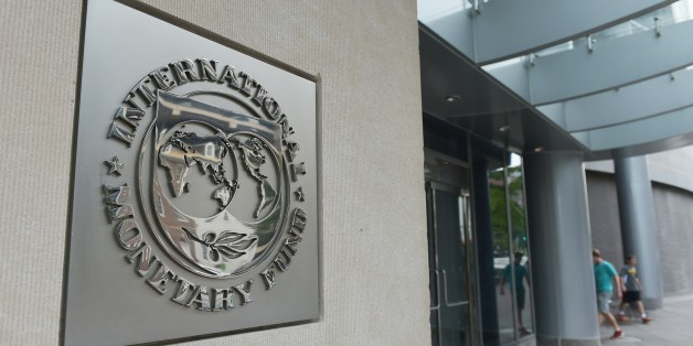 The seal of the International Monetary Fund is seen on a headquarters building in Washington, DC on July 5, 2015. The euro was dropping against the dollar after early results of the Greece bailout referendum suggested the country rejected fresh austerity demands from EU-IMF creditors. AFP PHOTO/MANDEL NGAN / AFP / MANDEL NGAN        (Photo credit should read MANDEL NGAN/AFP/Getty Images)