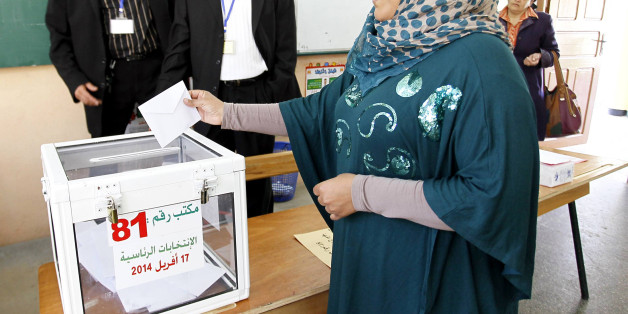 ALGIERS, ALGERIA - APRIl 17:  An Algerian woman casts her ballot for Algeria's presidential election at a polling station in Algiers, Algeria on April 17, 2014. Voting started Thursday in Algeria's presidential election, amid expectations that incumbent President Abdelaziz Bouteflika will win re-election. Six candidates, including Bouteflika, are contesting the Arab-African country's most coveted post. (Photo by Bechir Ramzy/Anadolu Agency/Getty Images)