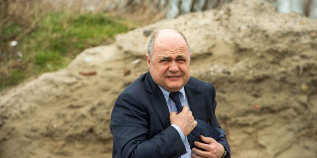 French interior minister Bruno Le Roux visits the former migrant camp of 'La Lande' in Calais on March 1, 2017, during the presentation of the site's remediation project by the shoreline's protection office. / AFP PHOTO / PHILIPPE HUGUEN        (Photo credit should read PHILIPPE HUGUEN/AFP/Getty Images)