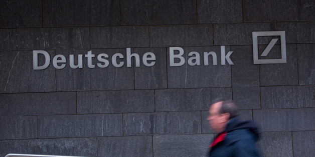 A pedestrian passes a Deutsche Bank AG office in Frankfurt, Germany, on Thursday, Feb. 2, 2017. Frankfurt expects as many 10,000 workers from Britain's financial services industry to relocate to Germany's banking capital because of Brexit, with the exodus likely to start within weeks, according to lobby group Frankfurt Main Finance. Photographer: Krisztian Bocsi/Bloomberg via Getty Images