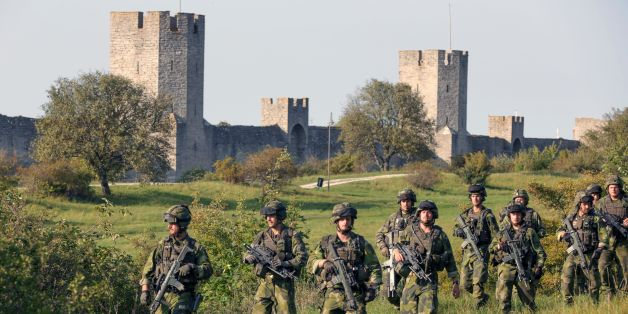 A squad from Skaraborg Armoured Regiment patrol outside Visby's 13th century city wall in Sweden on September 14, 2016.  Sweden's Baltic Sea island of Gotland is once again home to a permanent military presence, the military said, amid speculation over the country's ability to defend itself against a more assertive Russia. / AFP / TT NEWS AGENCY AND TT News Agency / SOREN ANDERSSON / Sweden OUT        (Photo credit should read SOREN ANDERSSON/AFP/Getty Images)