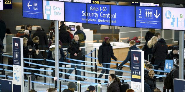 Passengers enter the security control area at the Helsinki airport in Vantaa, Finland March 10, 2017. Lehtikuva/Antti Aimo-Koivisto/via REUTERS   ATTENTION EDITORS - THIS IMAGE WAS PROVIDED BY A THIRD PARTY. FOR EDITORIAL USE ONLY. NO THIRD PARTY SALES.FINLAND OUT. NO COMMERCIAL OR EDITORIAL SALES IN FINLAND