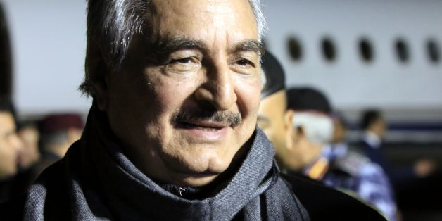 CORRECTION - Marshal Khalifa Haftar, the military leader of the so-called Libyan National Army and Libyas parallel parliament based in the eastern city of Tobruk, is greeted upon his arrival at Al-Kharouba airport south of the town of al-Marj, about 80 km east of the Mediterranean port city of Benghazi on December 3, 2016 after his visit in Russia.  / AFP / Abdullah DOMA / The erroneous mention[s] appearing in the metadata of this photo by Abdullah DOMA has been modified in AFP systems in the fo