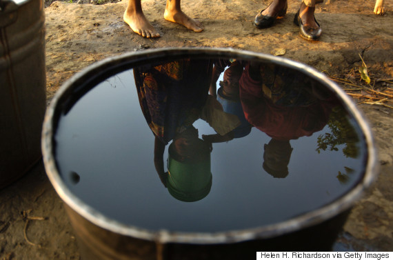 young women in malawi bucket of water