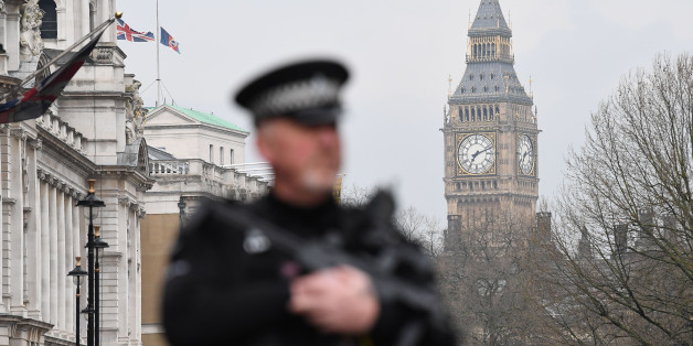 An armed police officer patrols by a security cordon set up along Whitehall by the Houses of Parliament on March 23, 2017 in London. Seven people have been arrested including in London and Birmingham over Wednesday's terror attack at the British parliament, the police said today, revising down the number of victims to three people. / AFP PHOTO / Justin TALLIS        (Photo credit should read JUSTIN TALLIS/AFP/Getty Images)