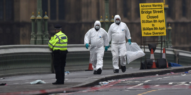 LONDON, ENGLAND - MARCH 23:  Police forensic officers work on Westminster Bridge following yesterday's attack, on March 23, 2017 in London, England. Four people have been killed and around 40 people injured following yesterday's attack by the Houses of Parliament in Westminster.  (Photo by Carl Court/Getty Images)