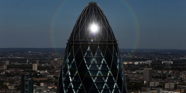 The sun reflects off the top of 30 St Mary Axe, also known as The Gherkin, in London, U.K., on Tuesday, Aug. 23, 2016. Commercial property prices are falling across London, as banks, corporations and ordinary people try to assess the business and economic fallout. Photographer: Chris Ratcliffe/Bloomberg via Getty Images