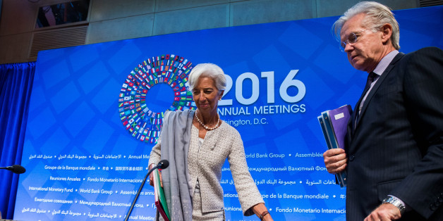 IMF Managing Director Christine Lagarde and IMF Spokesman Gerry Rice take their seats at the start of a press conference at the 2016 Annual Meetings of the International Monetary Fund Headquarters and the World Bank Group at the IMF on October 6, 2016 in Washington, DC. / AFP / ZACH GIBSON        (Photo credit should read ZACH GIBSON/AFP/Getty Images)