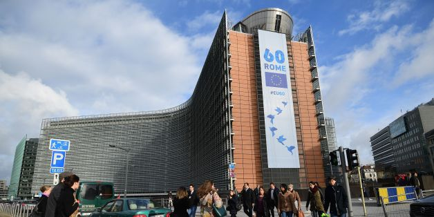 People walk past the European Commission on which is displayed a banner celebrating the 60 years after the signing of the Treaty of Rome, in Brussels on March 21, 2017.   European Union leaders gather in Rome this week to proclaim their 'common future' on the bloc's 60th birthday, despite a wave of crises including Britain's looming exit from the bloc. / AFP PHOTO / EMMANUEL DUNAND        (Photo credit should read EMMANUEL DUNAND/AFP/Getty Images)