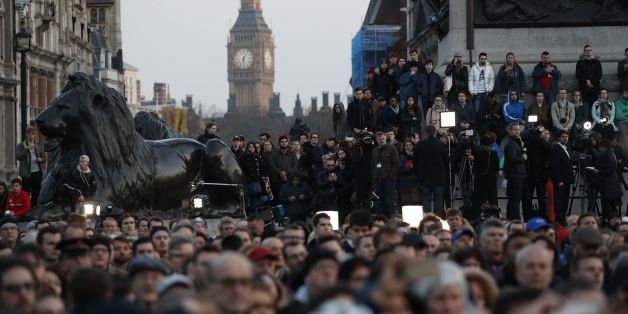 People gather for a vigil in Trafalgar Square in central London on March 23, 2017 in solidarity with the victims of the March 22 terror attack at the British parliament and on Westminster Bridge. 