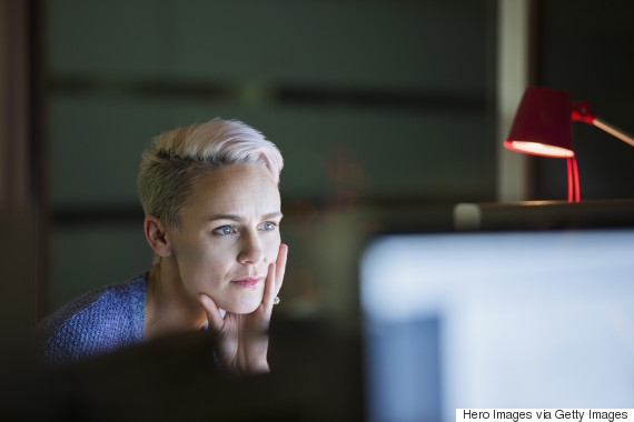 woman office night