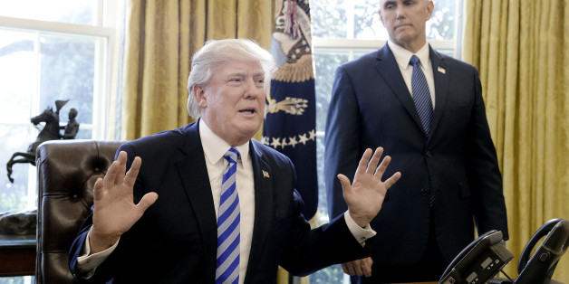 U.S. President Donald Trump, left, speaks to members of the media as U.S. Vice President Mike Pence stands at the Oval Office in Washington, D.C., U.S., on Friday, March 27, 2017. House Republicans abandoned their efforts to repeal and partially replace Obamacare after Trump and Speaker Paul Ryan concluded they didn't have enough support, marking an embarrassing setback for the GOP agenda. Photographer: Olivier Douliery/Pool via Bloomberg