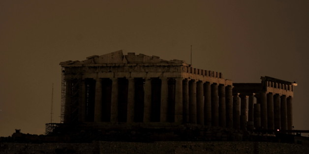 The ancient Parthenon Temple on top of the Acropolis hill is not floodlit as Greece participate in Earth Hour in Athens on March 27, 2010. More than 120 countries participate in turning off lights for 60 minutes from 8:30 to 9:30 in the evening local time in an effort to raise global awareness on climate change. AFP PHOTO / Aris Messinis (Photo credit should read ARIS MESSINIS/AFP/Getty Images)