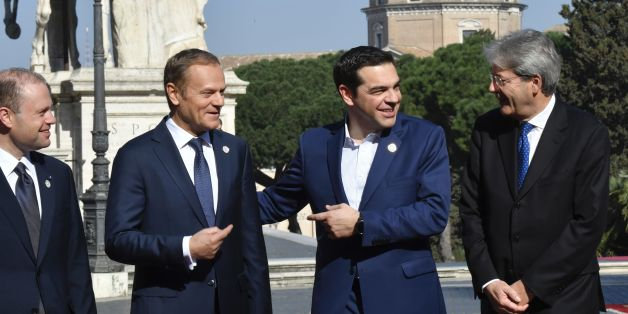 Greece's Prime Minister Alexis Tsipras (2-R) reacts, as Malta's Prime minister Joseph Muscat (L), European Council President Donald Tusk (2-L), and Italy's Prime Minister Paolo Gentiloni look on ahead of a special summit of EU leaders to mark the 60th anniversary of the bloc's founding Treaty of Rome, on March 25, 2017 at Rome's Piazza del Campidoglio (Capitoline Hill).   Meeting in the same Renaissance-era palace where six founding countries signed the Treaty of Rome on March 25, 1957, the 27 leaders minus Britain will endorse a declaration of intent for the next decade. / AFP PHOTO / Andreas SOLARO        (Photo credit should read ANDREAS SOLARO/AFP/Getty Images)