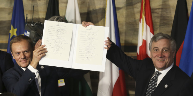 European Council President Donald Tusk (L) and European Parliament President Antonio Tajani hold up a document signed by EU leaders during their meeting on the 60th anniversary of the Treaty of Rome, in Rome, Italy March 25, 2017. REUTERS/Remo Casilli
