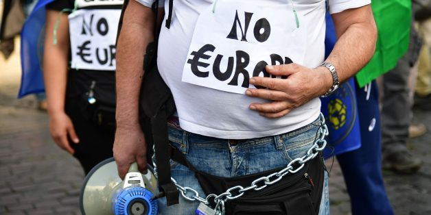 People take part in a demonstration against the European Union (Euro Stop) on March 25, 2017 in Rome. Italian capital hosts a special summit of European leaders today to mark the 60th anniversary of the bloc's founding treaties. / AFP PHOTO / Alberto PIZZOLI        (Photo credit should read ALBERTO PIZZOLI/AFP/Getty Images)