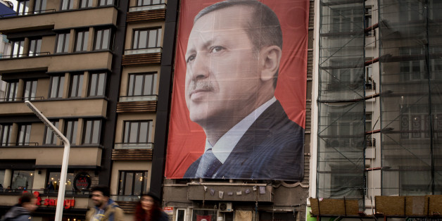 ISTANBUL, TURKEY - MARCH 13:  People walk past a large banner showing the portrait of Turkish President Recep Tayyip Erdogan in Taksim Square on March 13, 2017 in Istanbul, Turkey. Turkey will hold its constitutional referendum on April 16, 2017. Turks will vote on 18 proposed amendments to the Constitution of Turkey. The controversial changes seek to replace the parliamentary system and move to a presidential system which would give President Recep Tayyip Erdogan executive authority. Campaigning will officially begin on February 25 with a pro referendum rally to be held in Ankara and attended by Prime Minister Binali Yildirim.  (Photo by Chris McGrath/Getty Images)