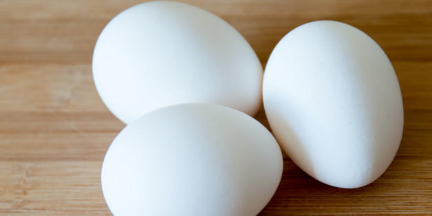 TORONTO, ONTARIO, CANADA - 2015/03/30: Eggs: realistic approach to food ingredients. Three white eggs over a wooden surface or cutting board in a kitchen, some shallow depth of field and natural lightning. (Photo by Roberto Machado Noa/LightRocket via Getty Images)