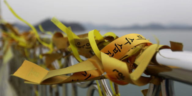 JINDO-GUN, SOUTH KOREA - MARCH 24:  Tribute flags to victims of the Sewol ferry disaster displayed on a pier at Paengmok harbour on March 24, 2017 in Jindo-gun, South Korea. The Sewol sank off the Jindo Island in April 2014 leaving more than 300 people dead and nine of them still remain missing. Workers are in the process of an attempt to raise the ferry from the water in the hope that the disasters' final victims will be found. (Photo by Chung Sung-Jun/Getty Images)