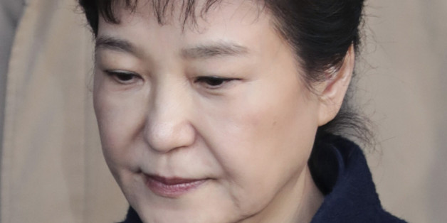 Former South Korean President Park Geun-hye, leaves the prosecutors' office in Seoul, South Korea, on Wednesday, March 22, 2017. South Korea's impeached president Park left the prosecutors office after investigators questioned her for 14 hours on allegations of influence-peddling, according to local media. Photographer: Lee Young-ho/Pool via Bloomberg