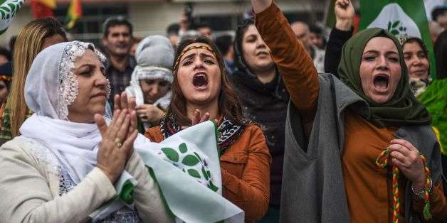 TOPSHOT - Women flash the victory sign during the Newroz celebrations for the new year on March 21, 2017 in Istanbul. 