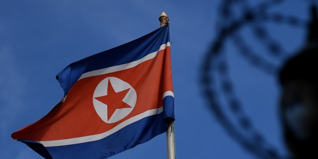 The North Korean flag is seen at mast past the barbed wire fencing of the North Korean embassy in Kuala Lumpur on March 27, 2017. The killing of the half-brother of North Korea's leader Kim Jong-Un last month in Kuala Lumpur International Airport with VX nerve agent triggered a bitter standoff between the previously friendly Asian nations, which have expelled each other's ambassador and refused to let their citizens leave. / AFP PHOTO / MANAN VATSYAYANA        (Photo credit should read MANAN VATSYAYANA/AFP/Getty Images)