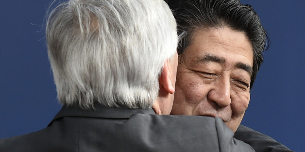 EU Commission President Jean-Claude Juncker (L) embraces Japan's Prime Minister Shinzo Abe before an EU-JAPAN Summit at the EU Headquarters in Brussels on March 21, 2017.Japanese Prime Minister Shinzo Abe pledged on March 21 to seal a EU-Japan trade deal as early as possible in order to make an important stand against protectionism. / AFP PHOTO / JOHN THYS        (Photo credit should read JOHN THYS/AFP/Getty Images)