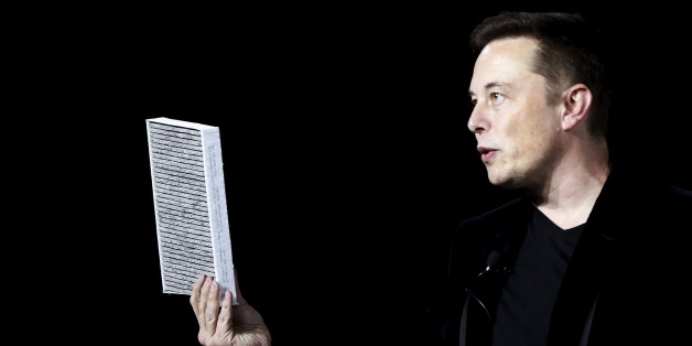 Tesla Motors CEO Elon Musk holds a car air filter during a presentation of the Model X electric sports-utility vehicle in Fremont, California September 29, 2015. Tesla Motors delivered the first of its long-awaited Model X electric sports-utility vehicles on Tuesday, a product investors are counting on to make the pioneering company profitable after years of losses. REUTERS/Stephen Lam