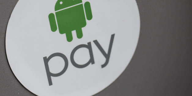 Signage for Google Inc.'s Android Pay is displayed outside a store in Hong Kong, China, on Tuesday, Nov. 1, 2016. The urgency to prepare regulatory environments for fintech is growing as banks begin offering digital services such as biometric authentication and as mobile-payment systems such as Apple Pay and AliPay are introduced around the region. Photographer: Anthony Kwan/Bloomberg via Getty Images