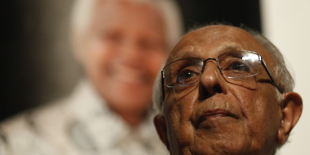 Anti-apartheid activist and close friend of former South African President Nelson Mandela, Ahmed Kathrada, talks during a tribute to Mandela at Gandhi Hall, on December 8, 2013 in Johannesburg. The revered icon of the anti-apartheid struggle in South Africa and one of the towering political figures of the 20th century, died in Johannesburg on December 5 at age 95. Mandela, who was elected South Africa's first black president after spending nearly three decades in prison, had been receiving treat