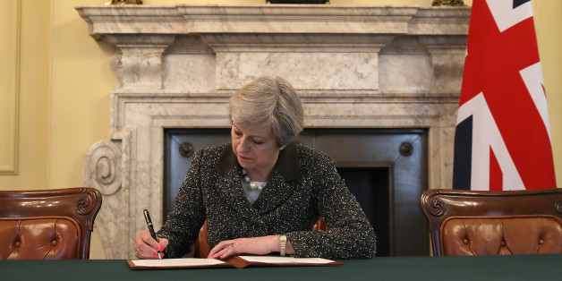 LONDON, ENGLAND - MARCH 28:  British Prime Minister Theresa May in the cabinet office signs the official letter to European Council President Donald Tusk invoking Article 50 and the United Kingdom's intention to leave the EU on March 28, 2017 in London, England. After holding a referendum in June 2016 the United Kingdom voted to leave the European Union, the signing of Article 50 now officially triggers that process.  (Photo by Christopher Furlong - WPA Pool/Getty Images)