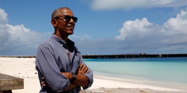 U.S. President Barack Obama smiles as he looks out at Turtle Beach on a visit to Papahanaumokuakea Marine National Monument, Midway Atoll, U.S., September 1, 2016. REUTERS/Jonathan Ernst