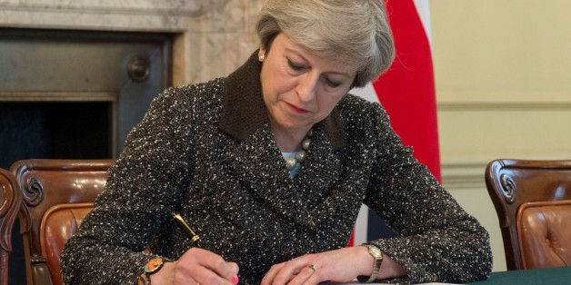 LONDON, UNITED KINGDOM - MARCH 28: : (----EDITORIAL USE ONLY  MANDATORY CREDIT - PRIME MINISTRY OF THE UNITED KINGDOM / HANDOUT ' - NO MARKETING NO ADVERTISING CAMPAIGNS - DISTRIBUTED AS A SERVICE TO CLIENTS----)  British Prime Minister Theresa May signs the official letter to European Council President Donald Tusk invoking Article 50 and the United Kingdom's intention to leave the EU on March 28, 2017 in London, England. After holding a referendum in June 2016 the United Kingdom voted to leave the European Union. (Photo by PRIME MINISTRY OF THE UNITED KINGDOM / HANDOUT /Anadolu Agency/Getty Images)
