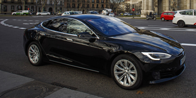 A Tesla Motors Inc. Model S electric automobile, operated Uber Technologies Inc., drives past the Puerta de Alcala in Plaza de la Independencia in Madrid, Spain, on Friday, Jan. 13, 2017. Ride-hailing service Uber Technologies has launched its first electric car taxi service in Madrid, operating a fleet of Tesla Model S electric vehicles. Photographer: Angel Navarrete/Bloomberg via Getty Images