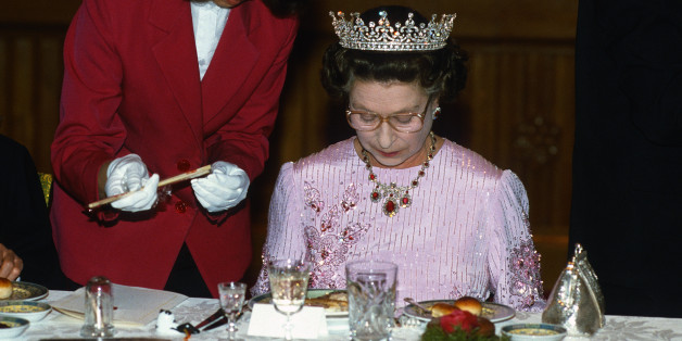 PEKING, CHINA - OCTOBER 13:  Queen Elizabeth ll is offered chopsticks as she studies her food during a State Banquet on October 13 ,1986 in Peking, China. The Queen is wearing the tiara known as 'Granny's Tiara' and a pink dress decorated with tree peony blossom, the national flower of China, designed by Ian Thomas.  (Photo by Anwar Hussein/Getty Images)