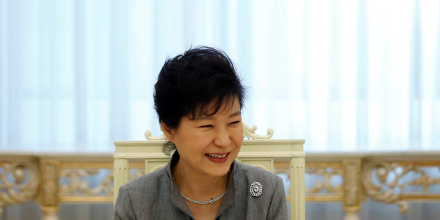 FILE PHOTO: South Korean President Park Geun-hye smiles as she listen to a reporter's question during an interview with Reuters at the Presidential Blue House in Seoul September 16, 2014.   REUTERS/Kim Hong-Ji/File Photo